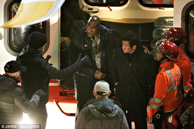 Tense: Dwayne was seen filming Skyscraper in Vancouver last Friday, his face covered in grime during a scene where he stood near a helicopter