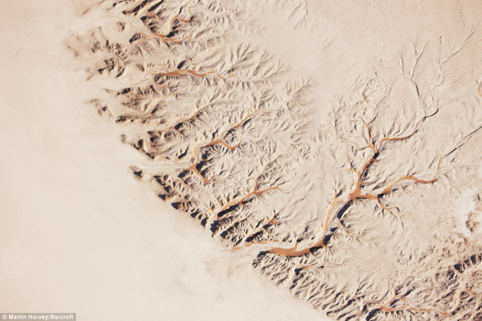 Arid: An other-wordly looking aerial view of the Hidden Vlei, an area of the Sossusvlei in the Namib Desert