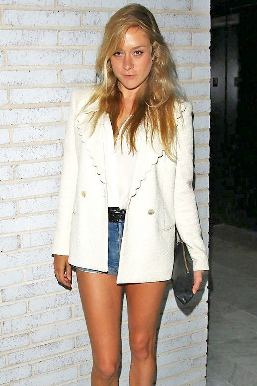 Le Fashion Blog Chloe Sevigny Scalloped White Blazer Silk Top Cut Off Jean Shorts Black Clutch Celebrity Summer Style Via Zimbio