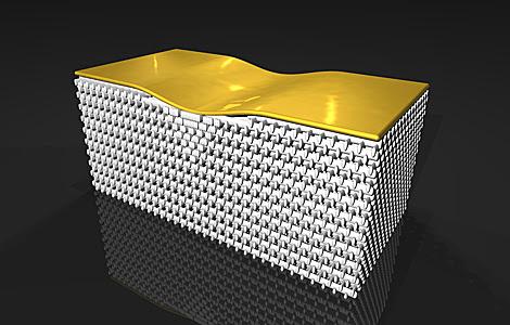 El objeto está recubierto de una alfombra dorada por encima y envuelto en la capa de invisibilidad por debajo. | AAAS