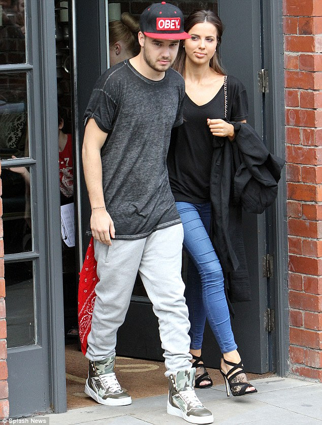 Reconciled: The 20-year-old looked casual as he walked ahead of Sophia shortly before his final concert in the city
