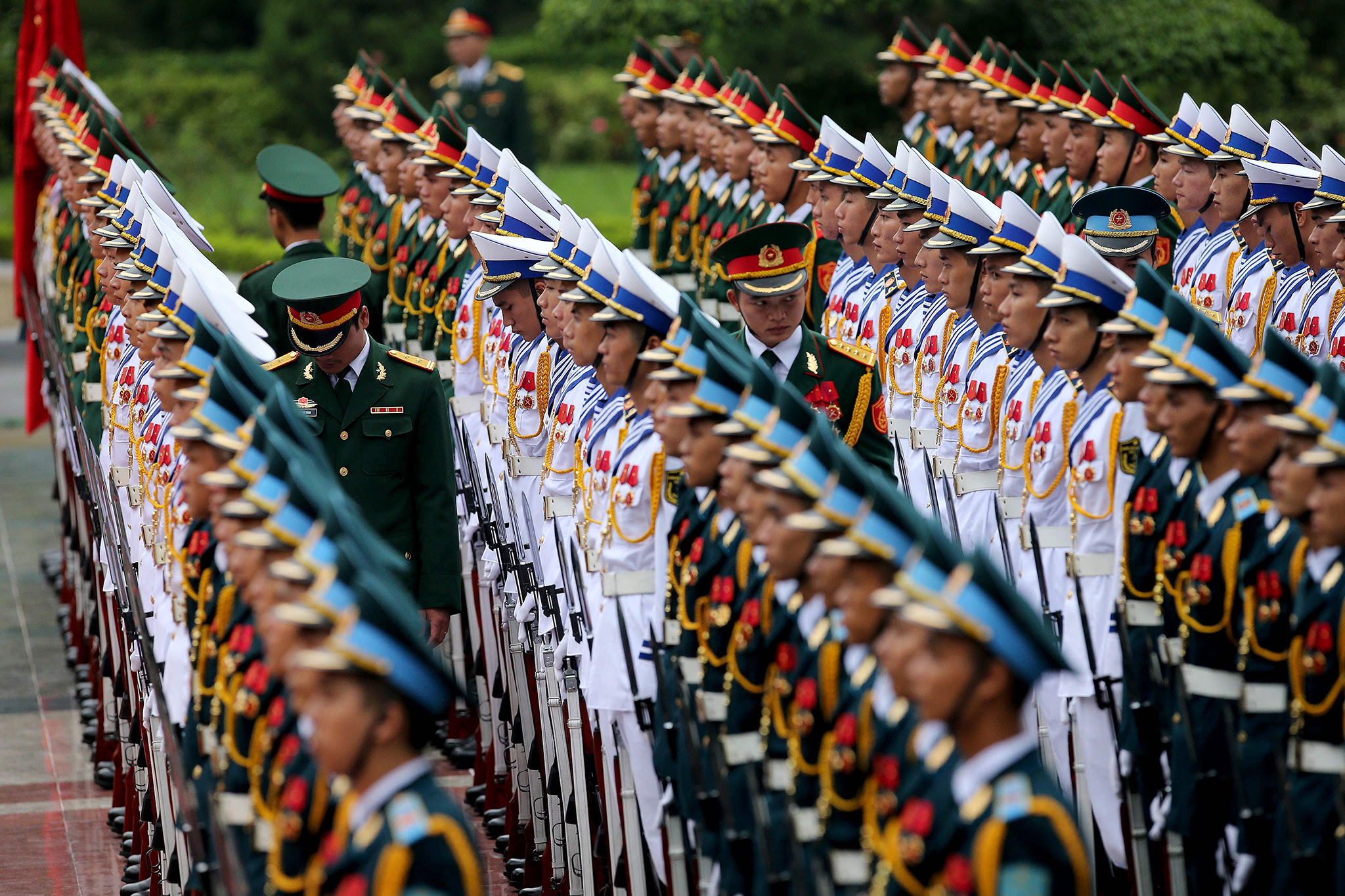 Members of the honor guard prepare before arrival of French President Francois Hollande (not pictured) at the Presidential Palace in Hanoi on September 6, 2016.   Holland is on a two day official visit. / AFP PHOTO / POOL / MINH HOANG / POOLMINH HOANG / POOL/AFP/Getty Images