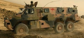 Photo montage of a Bushmaster 6wd armoured vehicle