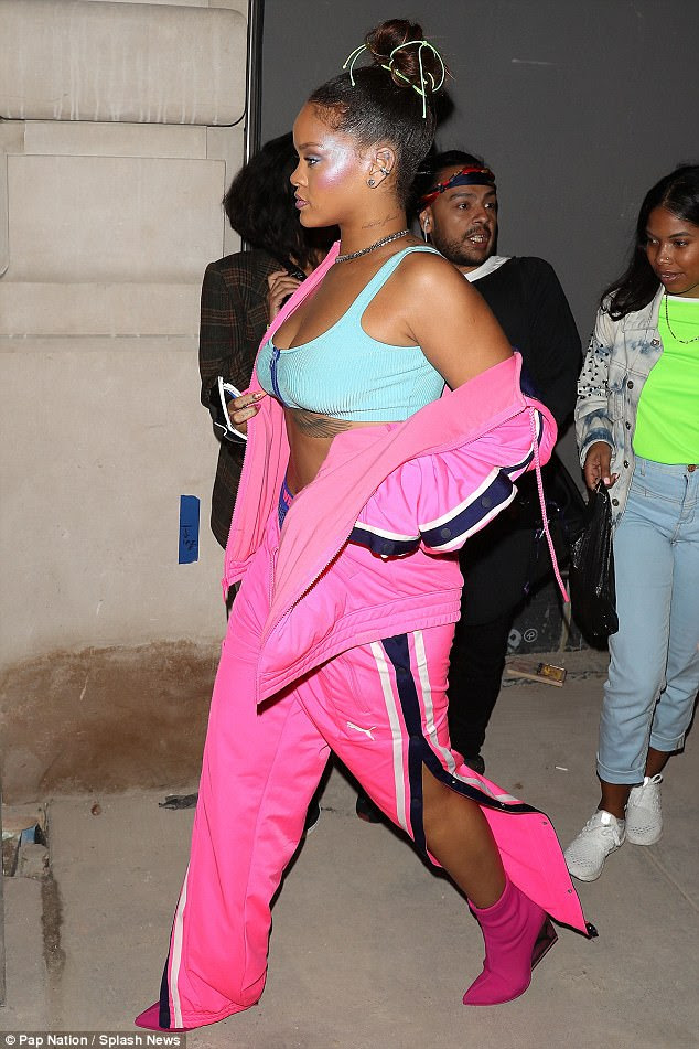 Style icon:Underneath, Rihanna showcased her ample bosom in a light blue sports bra with a dark blue zipper down the middle