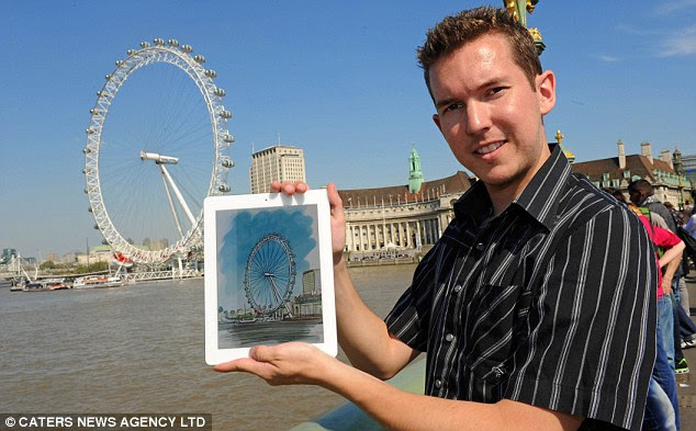 Wheely good: Kyle Lambert pictured with his version of the London Eye
