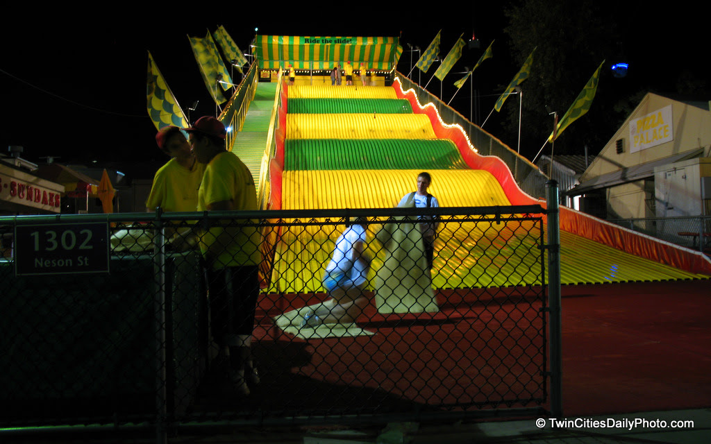 At $2 dollars per ride, it's one of the cheapest activities at the Minnesota State Fair. Granted, it takes you longer to walk up the stairs than it does to come down the yellow and green slide.