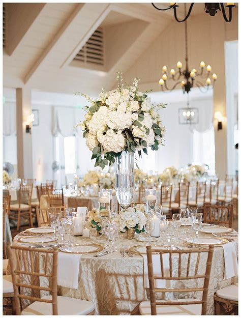 Gold, ivory and white wedding reception decor with white