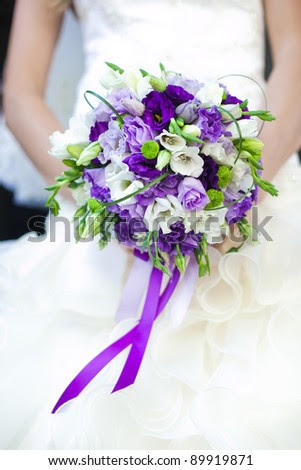 The bride holds the wedding bouquet