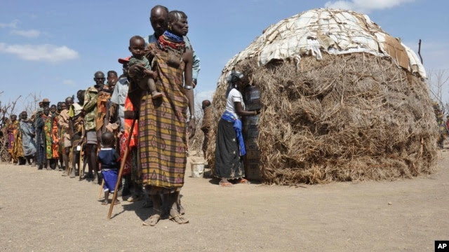 Turkana people wait in a line to receive food from Oxfam in central Turkana district, Kenya in August 2011. The U.N. says tens of thousands of people died in Somalia, Kenya, Ethiopia and Djibouti from famine. Five years later, drought has returned.