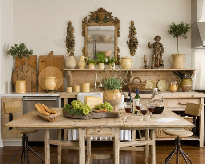 love all the natural woods, the pizza peels, bread boards and of course the pottery