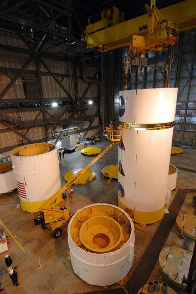 Various segments making up the upper stage simulator on the Ares I-X rocket are being mated together at Kennedy Space Center in Florida.