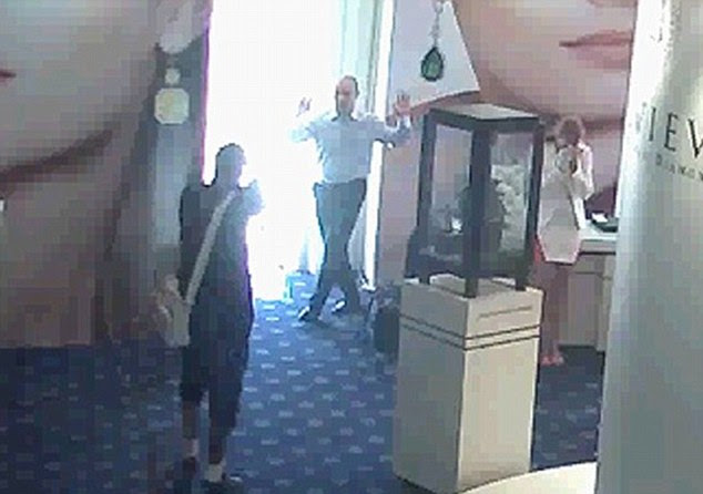 Caught on camera:Despite the romance and glamour surrounding their crimes, the gang does not shy away from using weapons and threatened customers and workers with guns during the 2013 Cannes raid