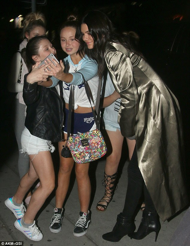 Gracious: Kendall gave in and posed for photos with the girls
