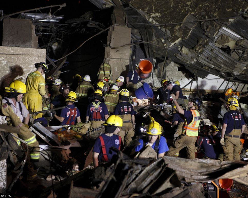 Through the night: A handout picture provided by the Oklahoma National Guard shows rescue personnel working to find survivors beneath rubble