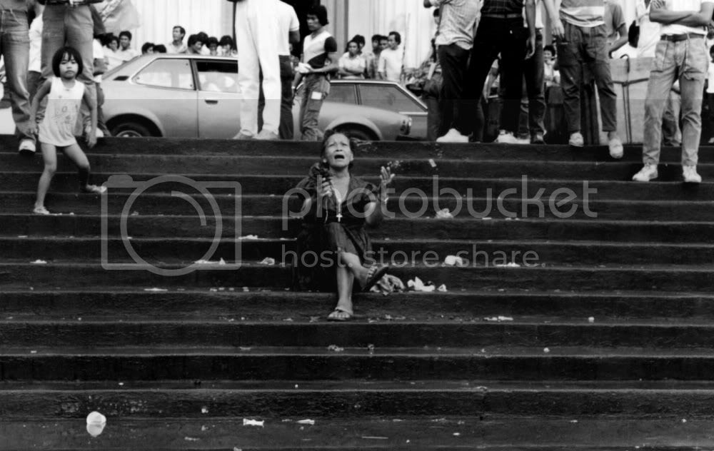 image of mad woman singing Bayan Ko on the steps of the Post Office, 1985. Philippines. Photo by Candy Gourlay.