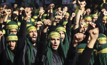 Lebanon's Hezbollah supporters gesture as they march in Beirut, November 2011