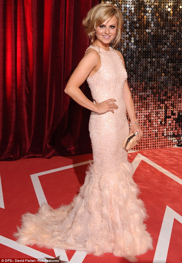 In the pink: Former Coronation Street actress Tina O'Brien wore a pale pink sequinned gown and feathered skirt