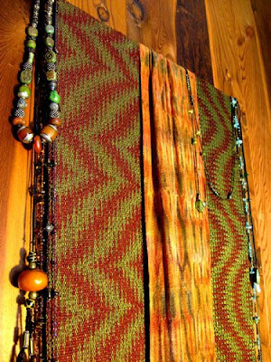 Tencel weavings displayed with jewelry