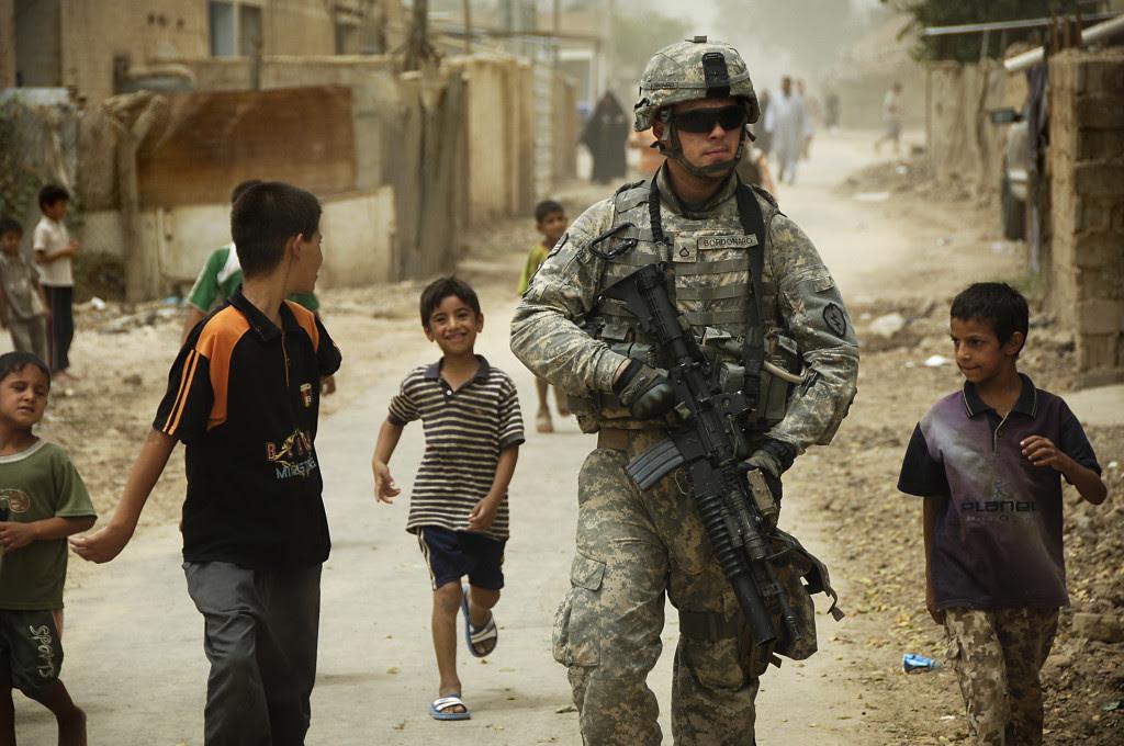 U.S. Army Pfc. Shane Bordonado patrols the streets of Al Asiriyah, Iraq, on Aug. 4, 2008