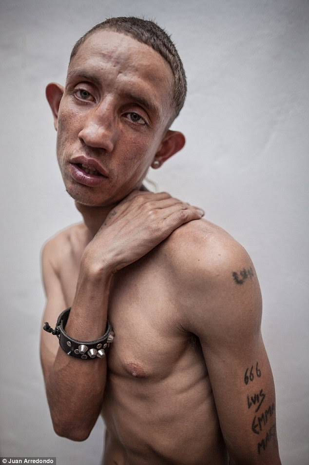 Despair: Orejas, 21, has been living on the streets of Barrio Triste since running away when he was 12