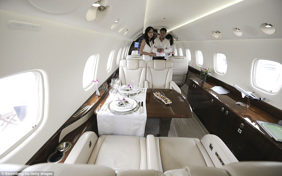 Tranquil: The interior of Jackie Chan's Embraer SA Legacy 650 jet is designed to be relaxing. The plane transports up to 14 people