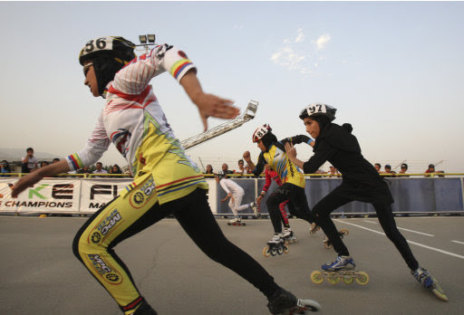Iranian female rollerbladers start their competition, during women's rollerblading championship league, at the Azadi (Freedom) sport complex, in Tehran, Iran, Thursday, June 30, 2011. (AP Photo/Vahid Salemi)
