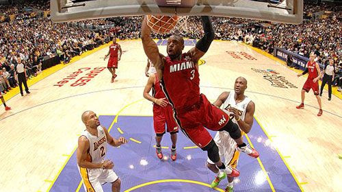 Dwyane Wade scores a dunk against the Lakers as the Miami Heat defeats the NBA champions, 96-80, on December 25, 2010.