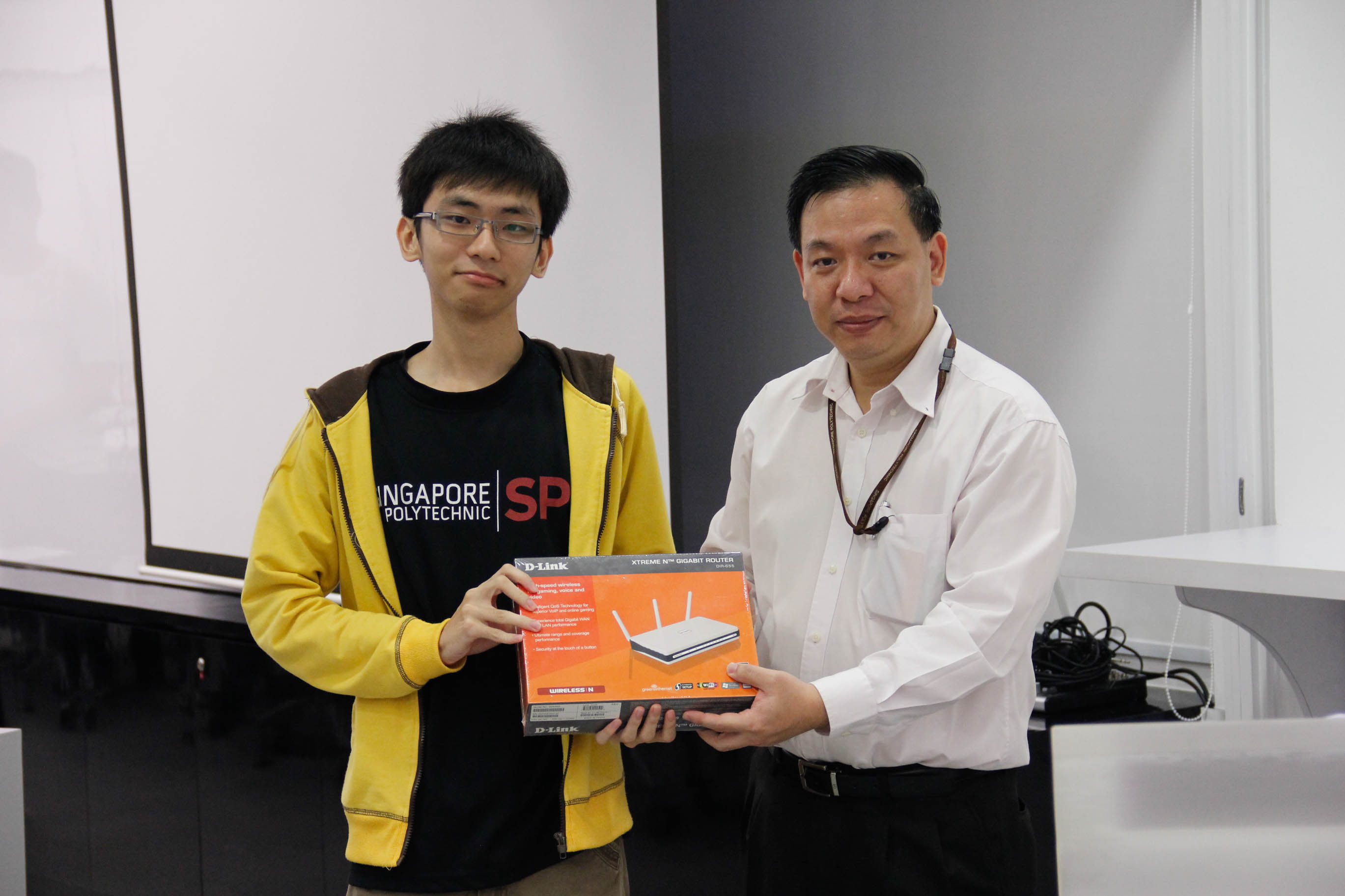 New ISACA Student Member, lucky draw grand winner as well as event photographer Dixon Soo with Mr Yeow