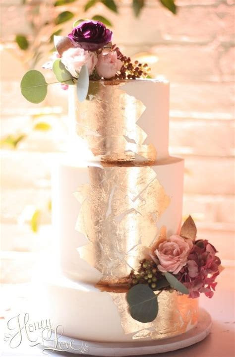 Buttercream wedding cake with edible gold leaf and fresh