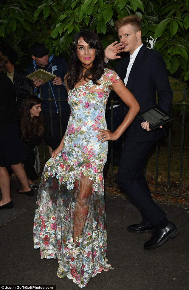 Looking good:The ex-girlfriend of Simon Cowell, 58, exuded summery elegance in a floral semi-sheer gown which effortlessly skimmed her lithe physique
