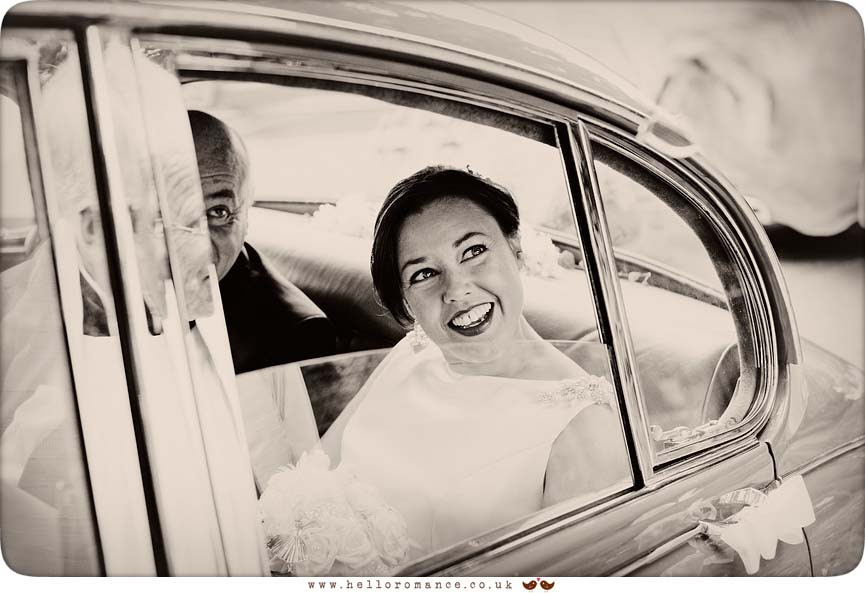 Bride and father in vintage Daimler wedding car - www.helloromance.co.uk