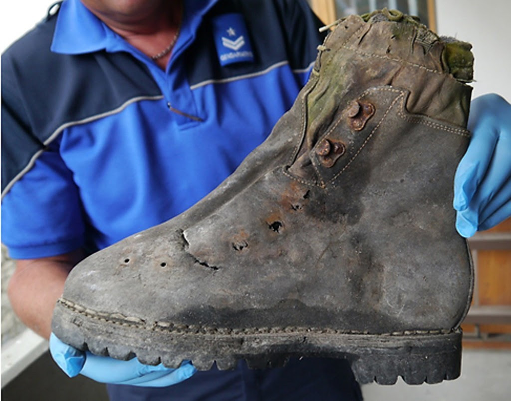 The Swiss police displayed a shoe found with the remains of two Japanese climbers who disappeared from the Matterhorn in the Alps in 1970. Credit Agence France-Presse — Getty Images