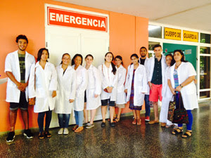 Photo: Courtesy of Elizabeth Amaya-Fernandez Students in front of a health clinic they visited in Cuba.