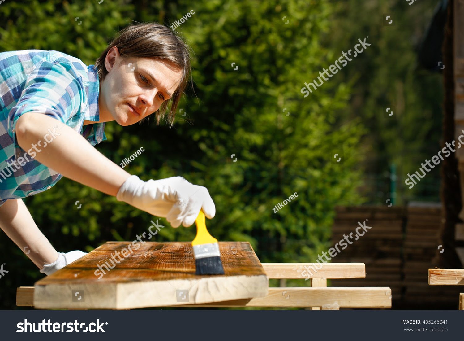 Woman Applying And Protecting Garden Furniture With Fresh ...