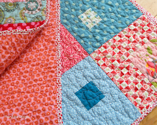 I Spy a Square Quilt folded with backing
