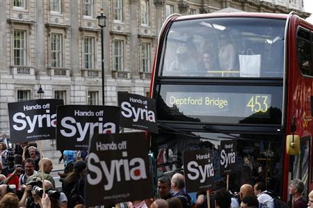 Protestors block Whitehall during a rally against the proposed attack on Syria in central London August 28, 2013. REUTERS-Olivia Harris