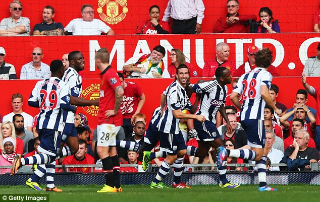 Shocker: West Brom run off to celebrate with Berahino after his 67th -minute winner