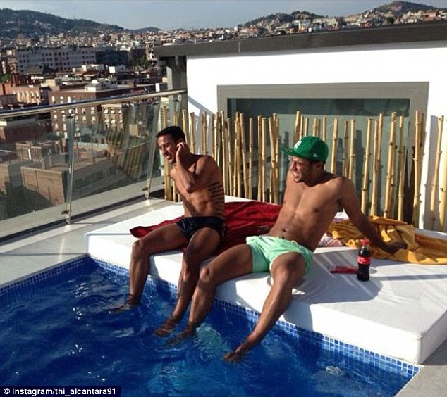 Affection: Thiago Alcantara (left) posted this snap with brother Rafinha and the caption 'I love Barcelona'