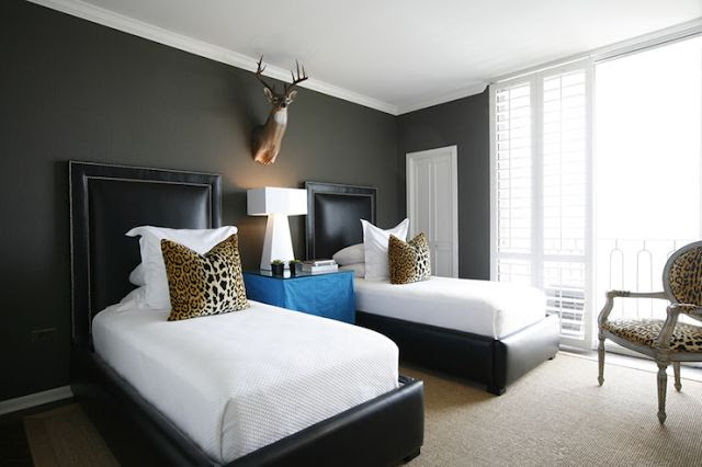 leopard as an accent in this otherwise black and white room