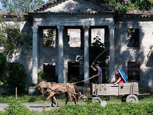 A horse cart pass by ruined hospital building in Bargebi village in Gali region of Abkhazia by hegtor