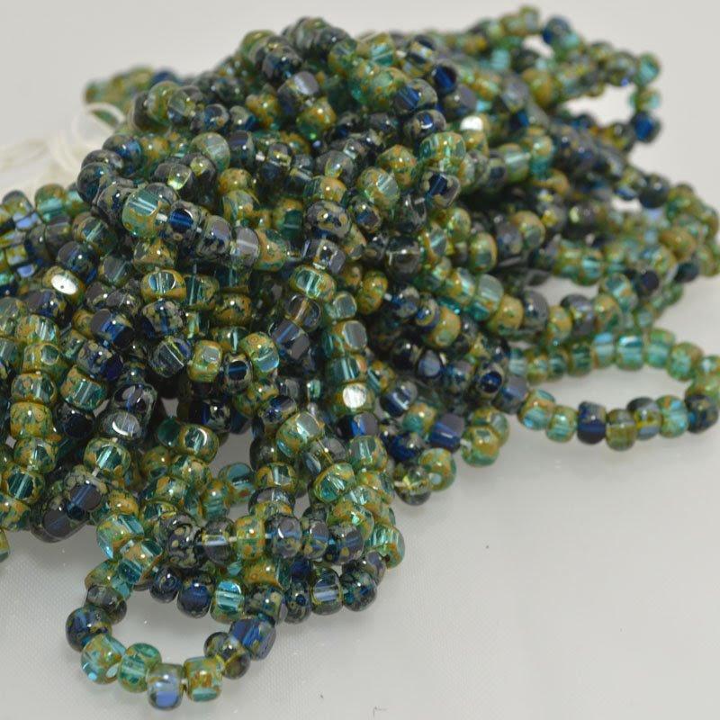 s43640 Czech Glass - 1/0 3-Cut Rocailles - Neptunes Hoard (strand)