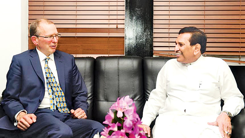 Health Minister Dr. Rajitha Senaratne in discussion with Canadian High Commissioner David McKinnon.