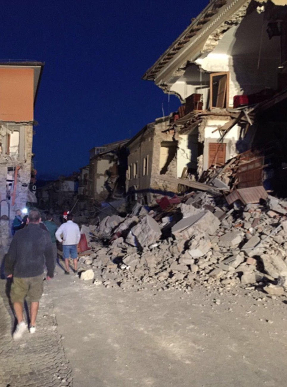A once quiet and picturesque street is seen with locals going about their daily lives (left) before the earthquake. On Wednesday the beautiful balcony of the building collapsed into a pile of rubble (right)