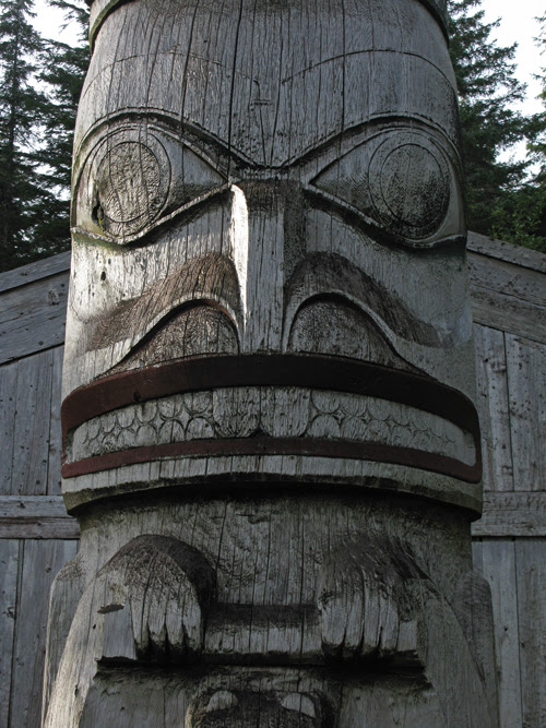 beaver figure in front of Chief Son-i-Hat Whale House, Kasaan, Alaska