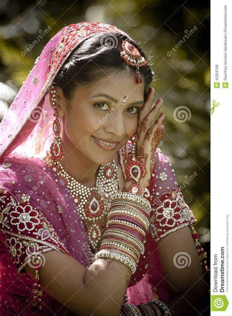 Young Beautiful Indian Hindu Bride Sitting In Garden