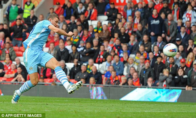 That does it: Dzeko rounds off the scoring with a cool finish for City's sixth goal