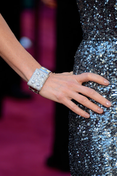 Actress Naomi Watts (jewellery detail) arrives at the Oscars at Hollywood & Highland Center on February 24, 2013 in Hollywood, California.