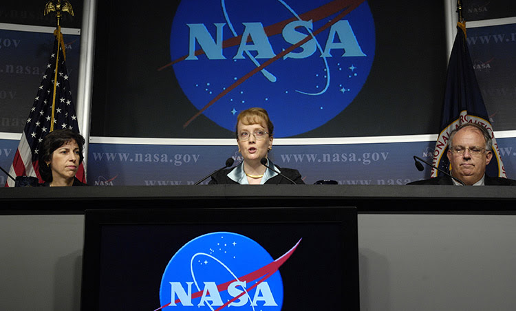 """Ellen Ochoa, director of flight crew operations, NASA Johnson Space Center, Houston (left), Shana Dale, NASA deputy administrator, NASA Headquarters, Washington and Dr. Richard S. Williams, chief health and medical officer (center), NASA Headquarters answer questions during a news conference to discuss the findings of two reviews regarding astronaut medical and behavioral health assessments, Friday, July 27, 2007, at NASA Headquarters in Washington. Photo Credit: """"NASA/Bill Ingalls"""