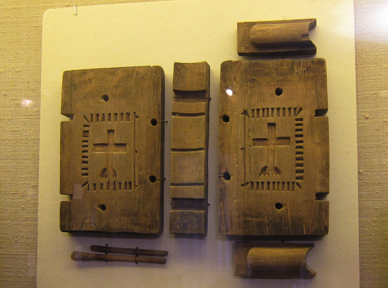 A carved maple sugar mold in the shape of a bible, likely meant for a communal holiday meal or funeral (c. 1820s)