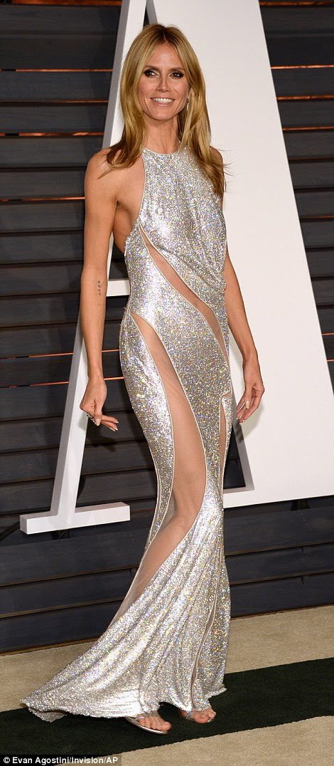 The model looked stunning in her revealing silver dress